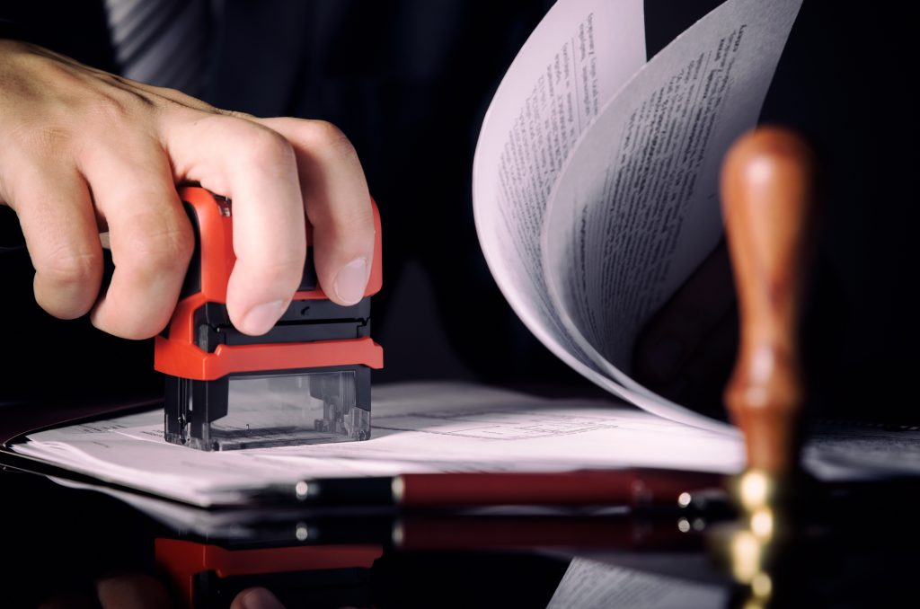 lawyer notarizing a document